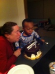 Blurry :(  Nate helping Bubbie blow out her birthday candle!
