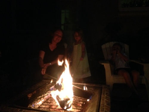 Jodi and her kids making S'mores