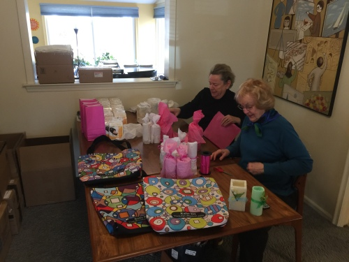 Tammy and Barbara wrapping LED candles